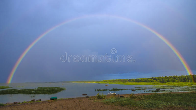 Sky bridge. After heavy rain with thunderstorm came absolute silence and a rainbow appeared royalty free stock photography