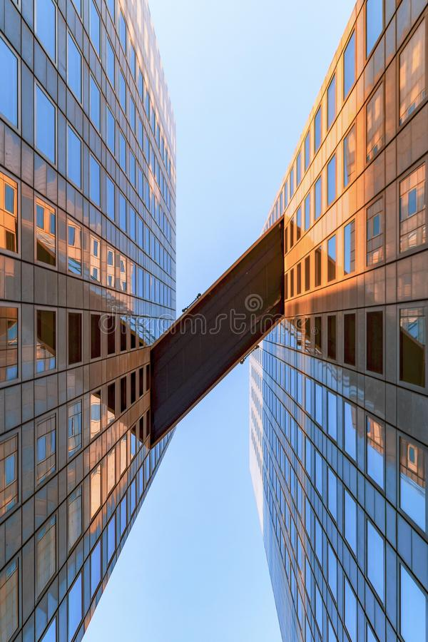 Sky Bridge between Offices building. Sky Bridge between modern glass and mirror of office buildings abstract royalty free stock photo