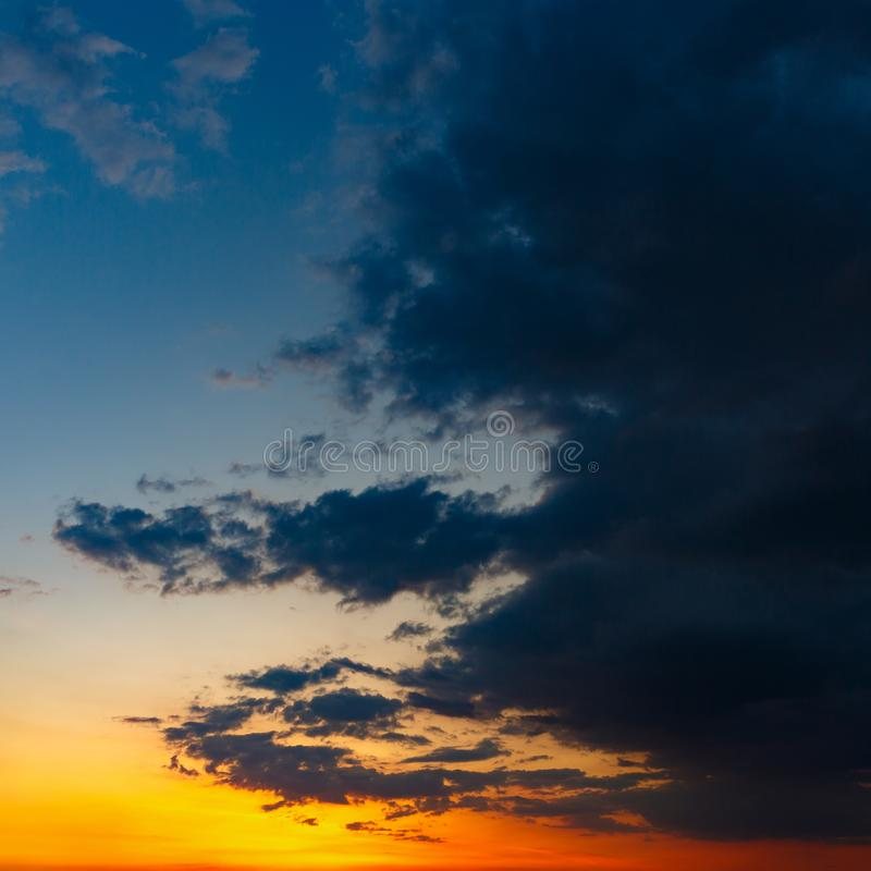 The sky with bright clouds lit by the sun after sunset.  stock image