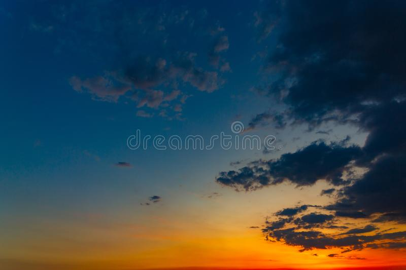 The sky with bright clouds lit by the sun after sunset.  stock photography