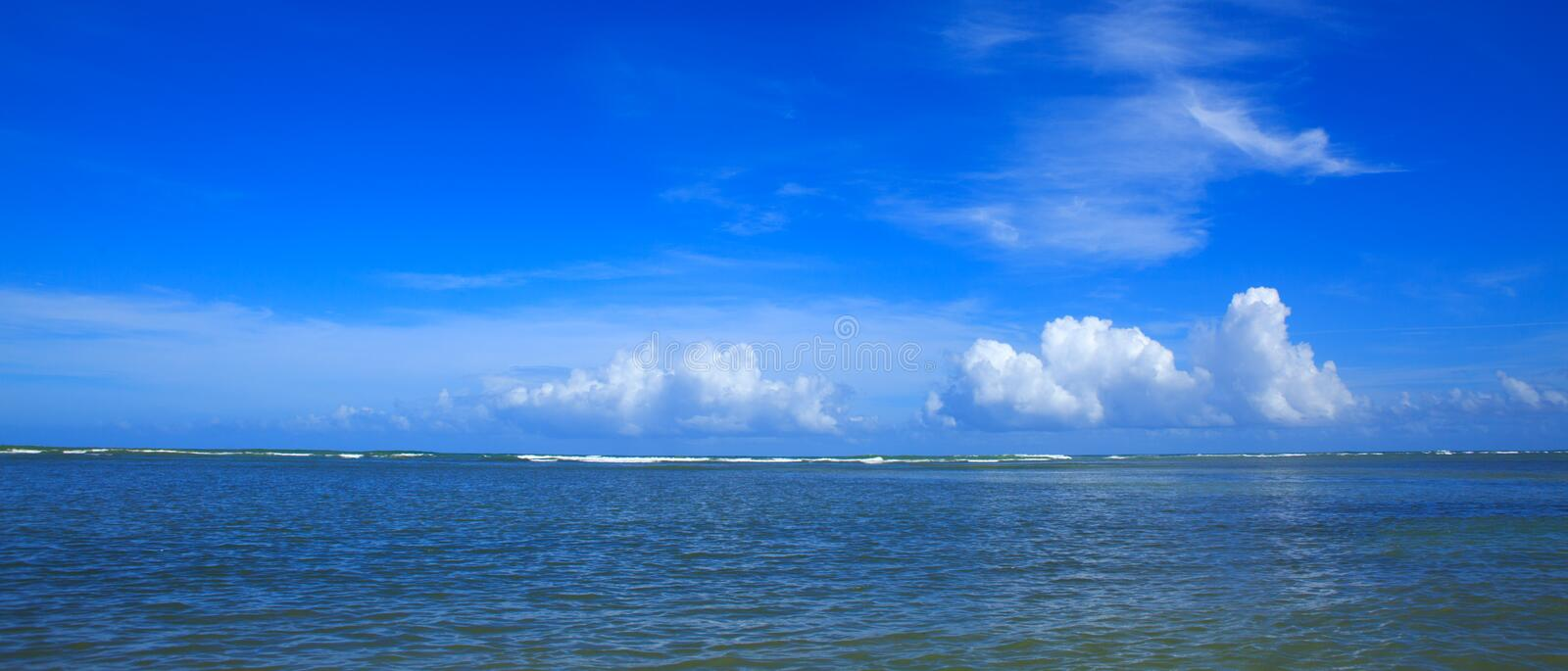 Beautiful tropical seascape and blue sky. Panorama of sea waves. royalty free stock photography