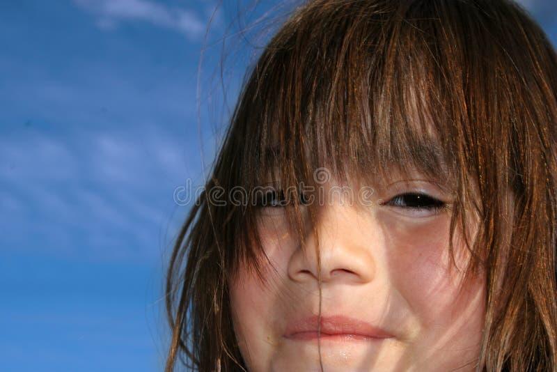 Sky Child. Closeup portrait of hispanic child against blue sky royalty free stock photos