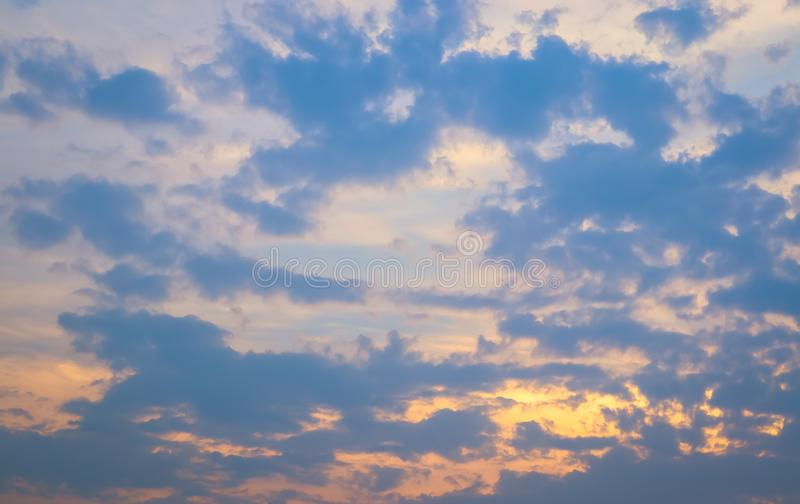 Sky and cloud at the sunset time. The orange warm light frome the sunset spread out the light through the cloud. Background image royalty free stock image