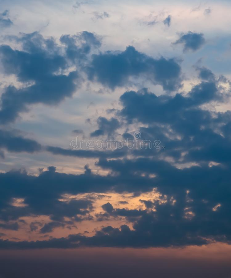 Sky and cloud at the sunset time. The orange warm light frome the sunset spread out the light through the cloud. Background image stock photography