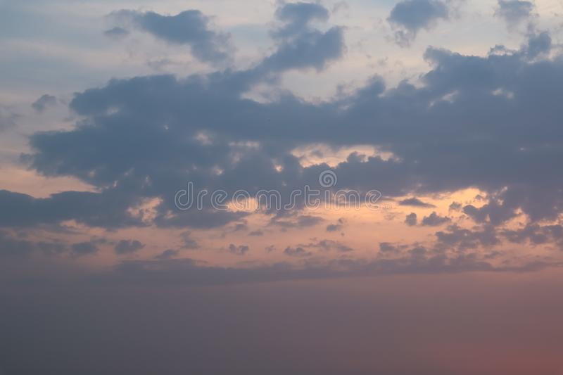 Sky and cloud at the sunset time. The orange warm light frome the sunset spread out the light through the cloud. Background image stock images