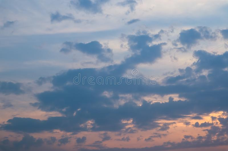 Sky and cloud at the sunset time. The orange warm light frome the sunset spread out the light through the cloud. Background image. Sky and cloud at the sunset royalty free stock photography