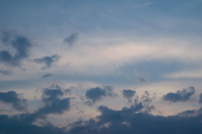Sky and cloud at the sunset time. The orange warm light frome the sunset spread out the light through the cloud. Background image. Sky and cloud at the sunset stock photos