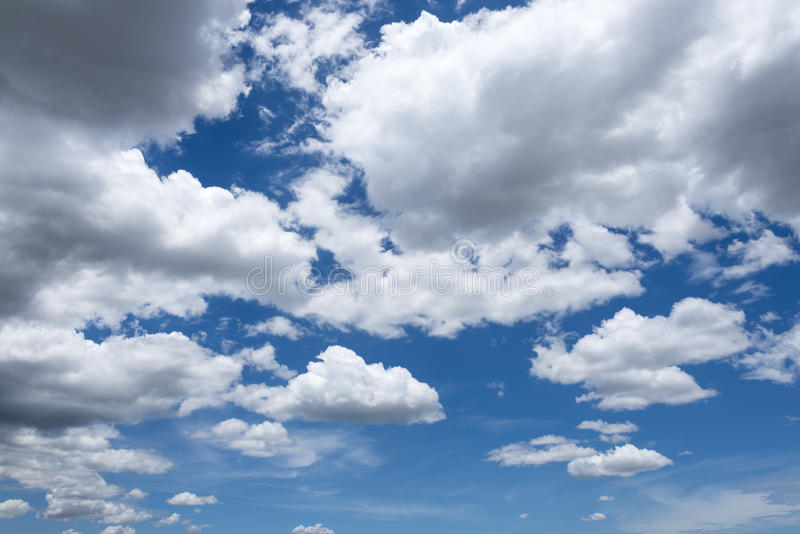 Sky clouds. Abstract background of blue sky with white clouds and rain clouds royalty free stock image