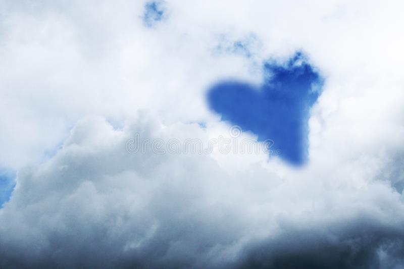 Sky clouds background, The shape of a heart. stock photo