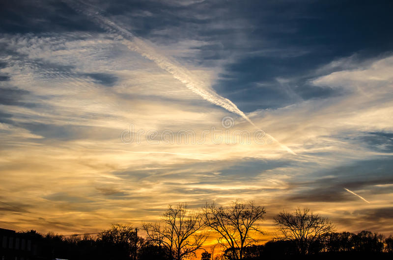 Sky Clouds blue to orange. Evening sky with clouds and sun setting. Orange to blue gradient sky royalty free stock photo