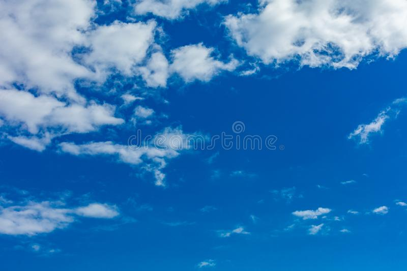 Sky with clouds. Deep blue bright sky with clouds background stock image