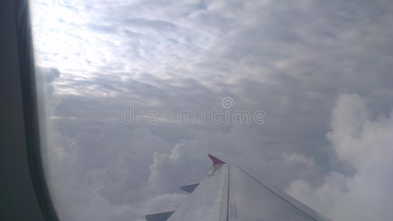 Sky clouds flight wings royalty free stock photo
