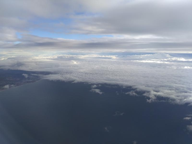Sky, clouds, land, sea stock photography
