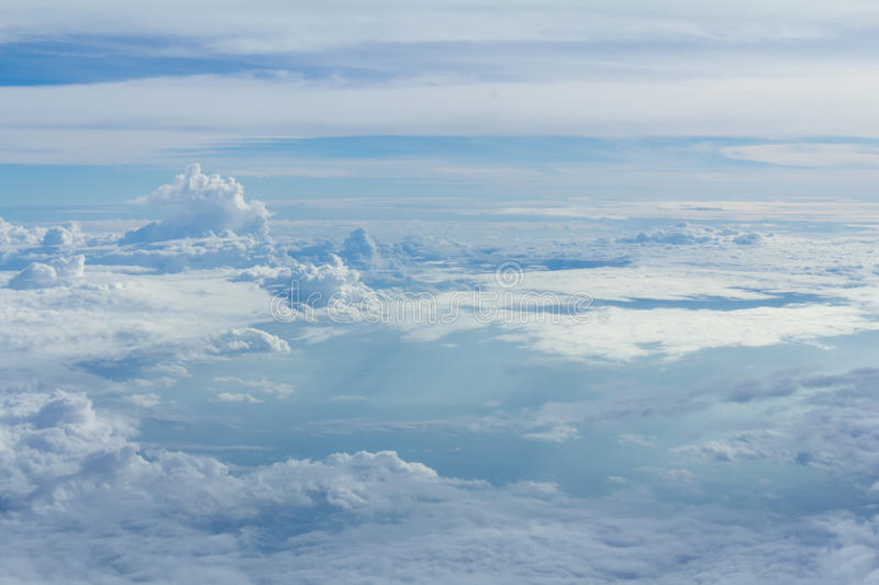 Sky and clouds looking form airplane window. Airplane view stock photography