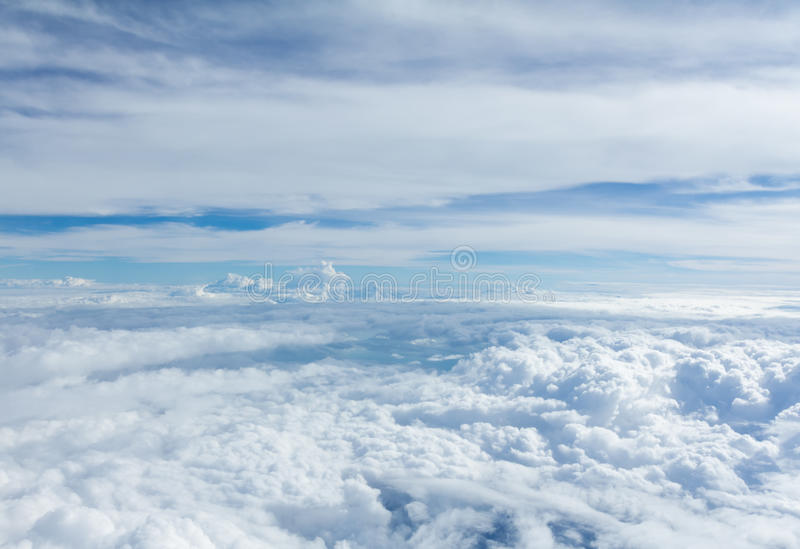 Sky and clouds looking form airplane window. Airplane view royalty free stock images