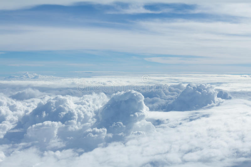 Sky and clouds looking form airplane window. Airplane view stock photos