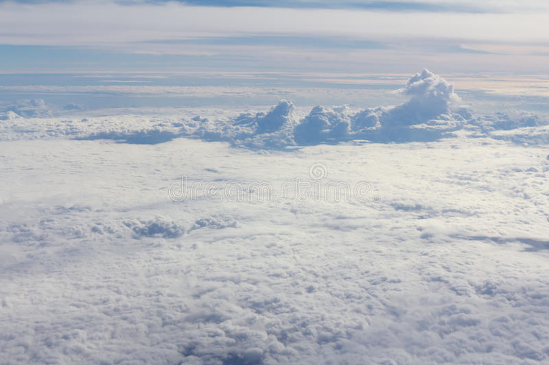 Sky and clouds looking form airplane window. Airplane view royalty free stock photos