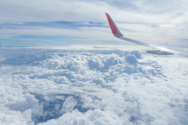Sky and clouds looking form airplane window. Airplane view stock image