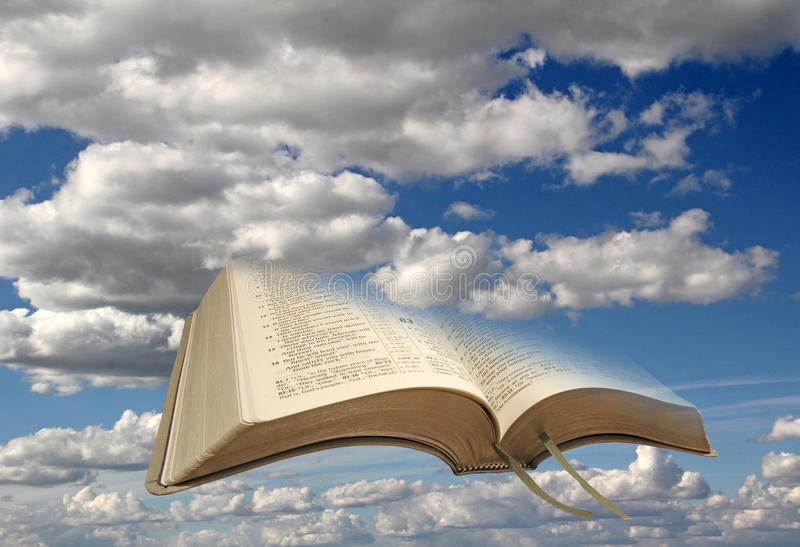 Sky clouds and open bible royalty free stock photos