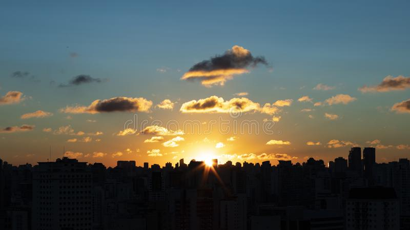 Sky with clouds over the evening city with sunset. Sao Paulo city, Brazil. stock photo