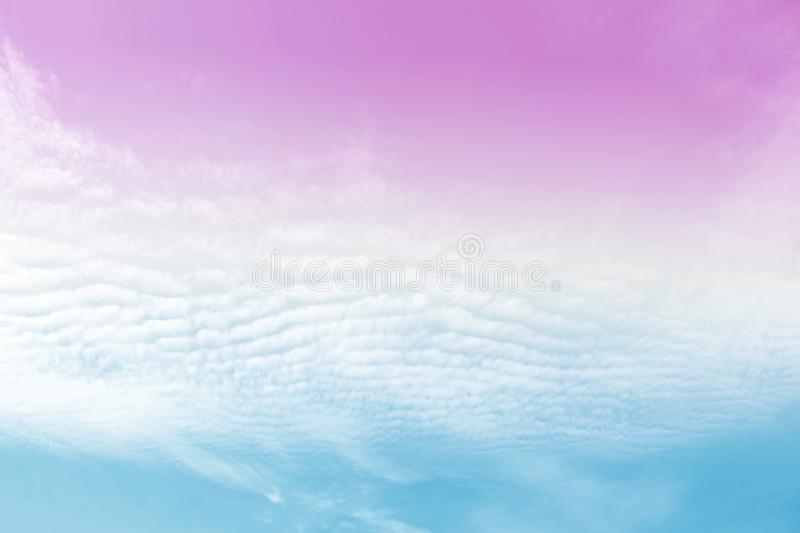 Sky clouds with a pastel colored orange to blue gradient. Background stock images