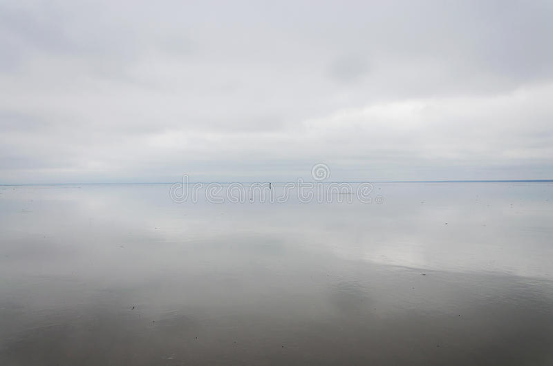 Sky and clouds reflected in the mirrored surface of lake Elton. royalty free stock photos