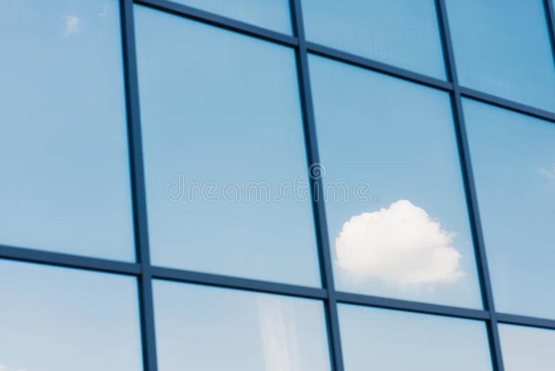 Sky and clouds reflection in the windows of modern royalty free stock image