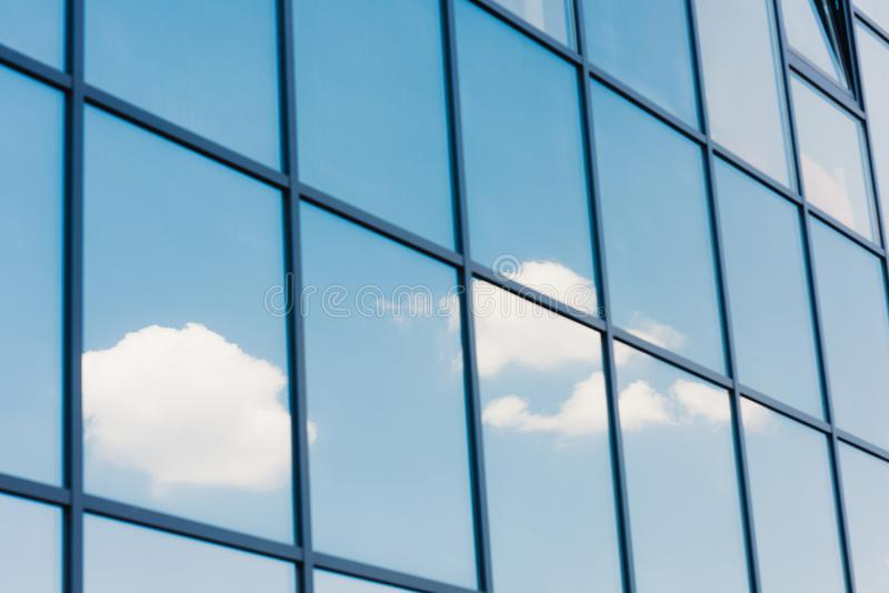 Sky and clouds reflection in the windows of royalty free stock photo