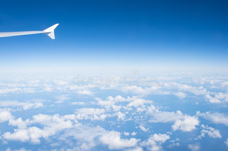 Sky and clouds seen from plane window. Atmosphere, stratosphere, air. Cloudscape, weather, nature. Wanderlust, adventure, discover stock images
