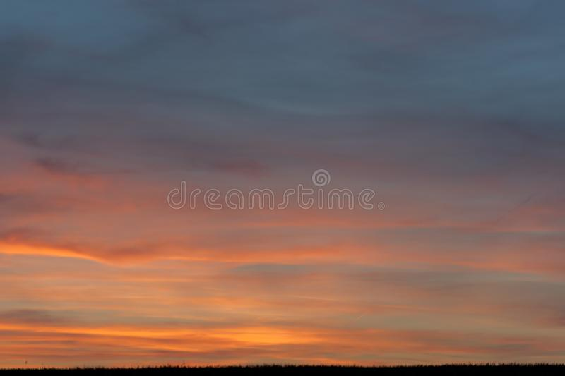 Sky with clouds and sun. Skies, backgrounds, suns, blues, beautifuls, beauties, natures, cloudscapes, lights, brights, colors, outdoors, sunlights, weathers stock image