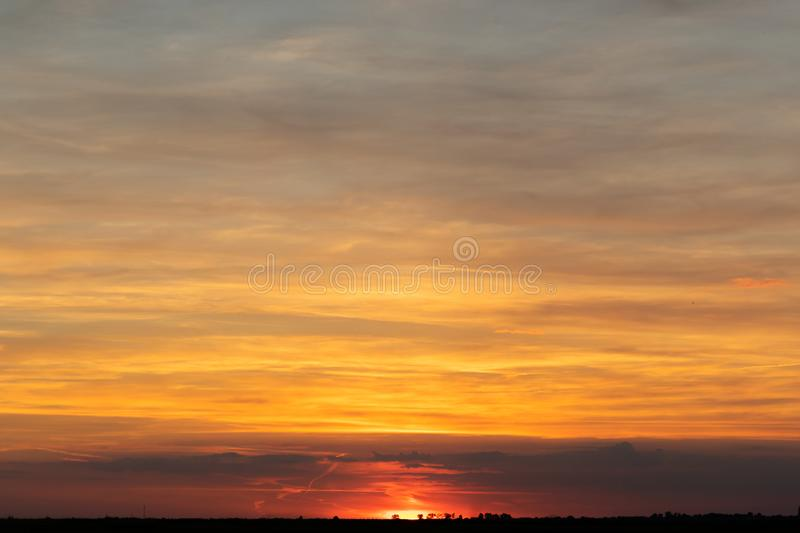 Sky with clouds and sun. Skies, backgrounds, suns, blues, beautifuls, beauties, natures, cloudscapes, lights, brights, colors, outdoors, sunlights, weathers royalty free stock photos