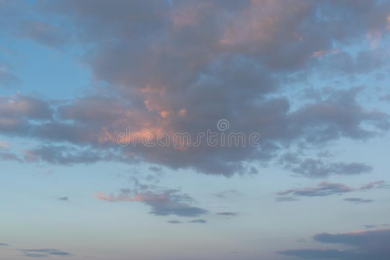 Sky with clouds and sun. Skies, backgrounds, suns, blues, beautifuls, beauties, natures, cloudscapes, lights, brights, colors, outdoors, sunlights, weathers royalty free stock images