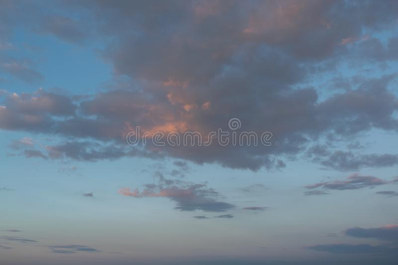 Sky with clouds and sun. Skies, backgrounds, suns, blues, beautifuls, beauties, natures, cloudscapes, lights, brights, colors, outdoors, sunlights, weathers royalty free stock photo