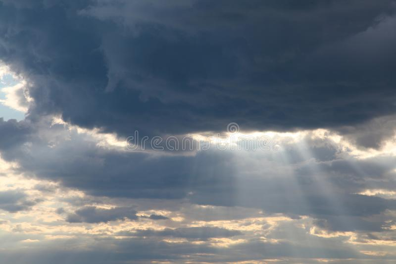 Sky clouds sun rays from the cloud blue stock image