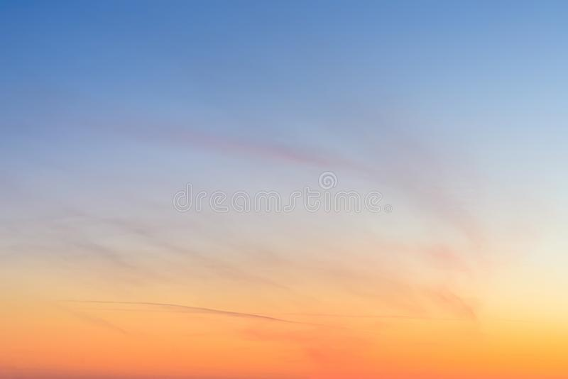 Sky and clouds at sunset, abstract colorful background, orange and blue. stock photography