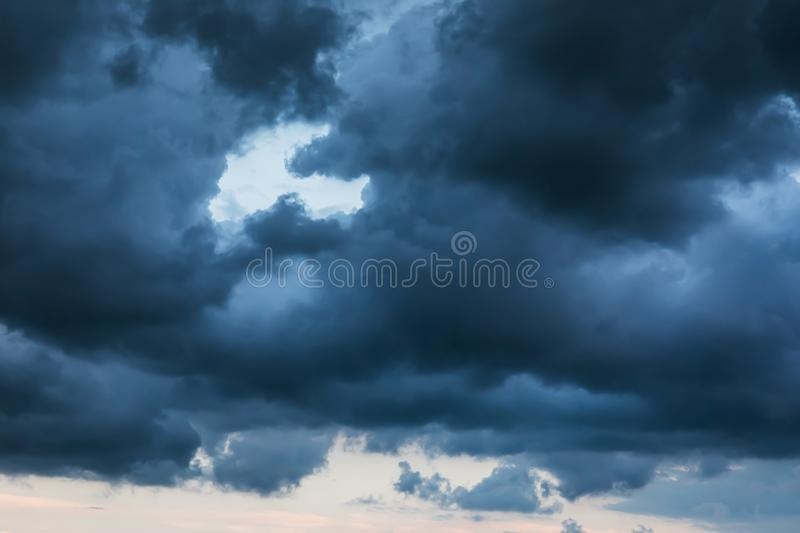 The sky is covered with rain clouds stock photos