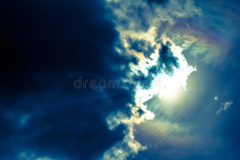 Sky with cumulus clouds and sun. royalty free stock image
