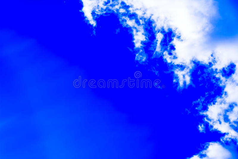 Sky with cumulus clouds and sun. stock photo