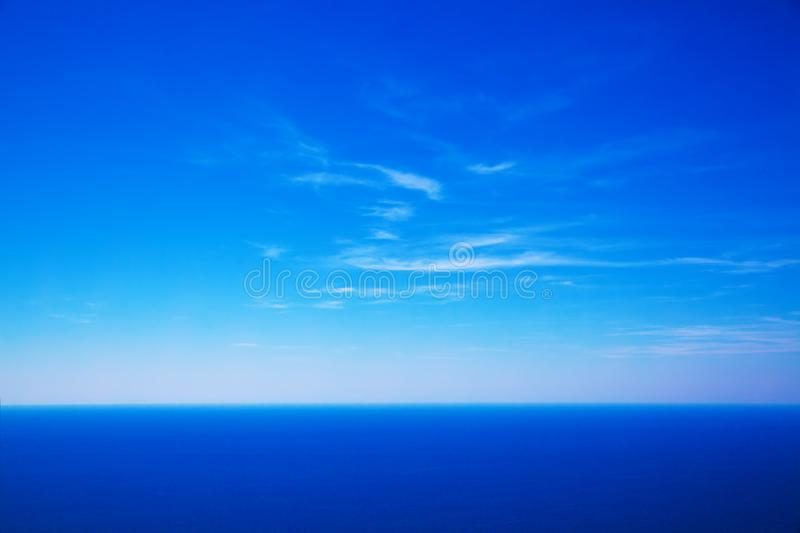 Sky and deep blue sea. May use as background royalty free stock photo