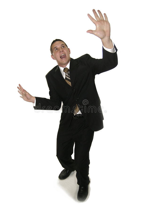 The Sky is Falling. Businessman in abject fear about to be crushed by something stock photography