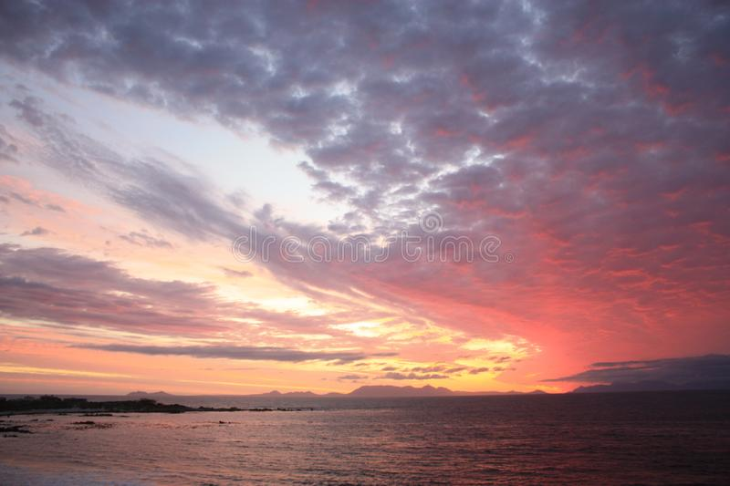 Beautiful Sky during Sunset in Cape Town South Africa. Sky on fire with colorful clouds with a panoramic view on the Atlantic Ocean near Cape Town southafrica stock images