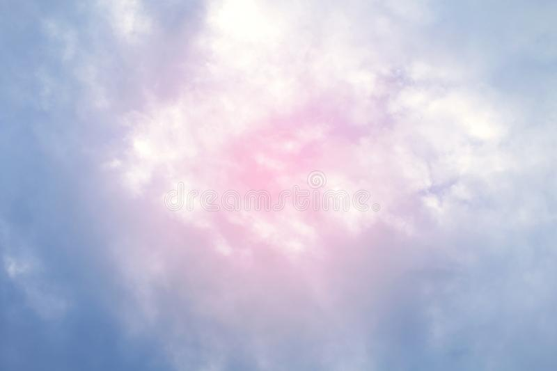 Sky fluffy pink blue soft purple multicolored background beautiful sky with pink clouds, two tone sky background colorful. The sky fluffy pink blue soft purple stock photo