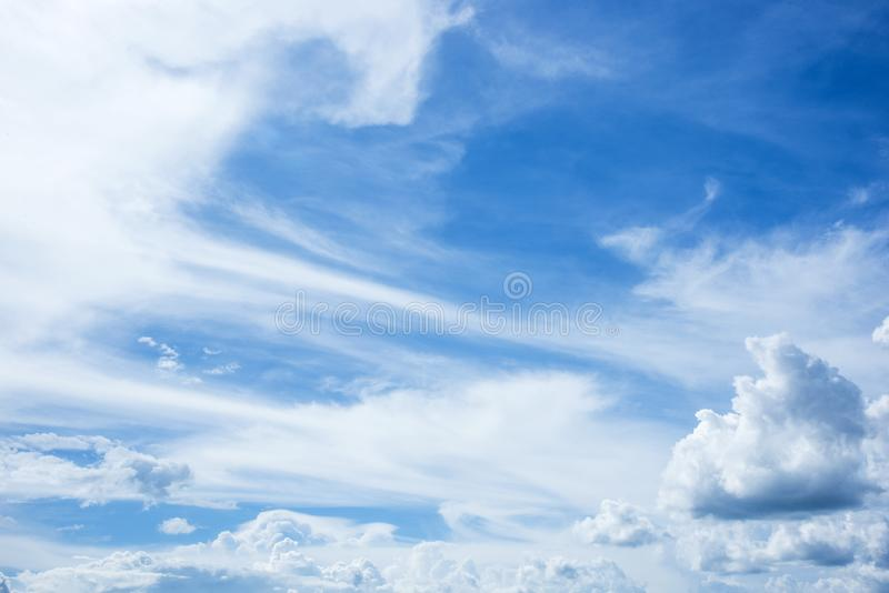 The sky is full of clouds on a clear day. stock images