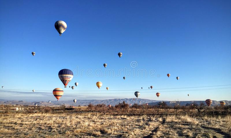 The sky full of colourful hot balloons stock photography
