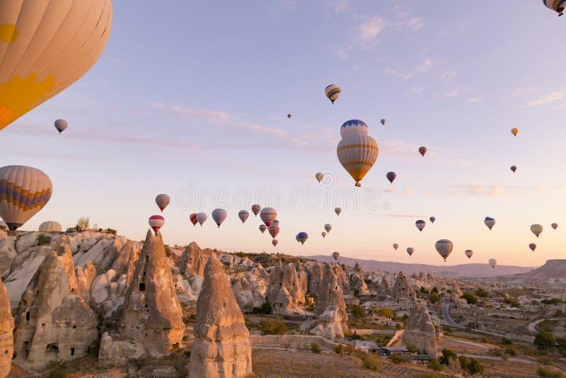 Sky full of hot air balloons at dawn in Cappadocia royalty free stock images