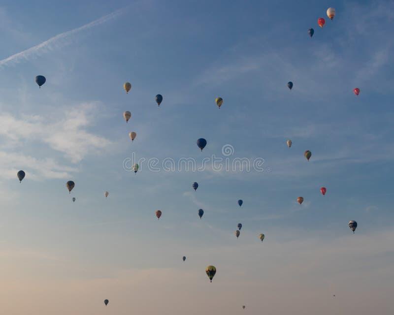 Sky full of hot air balloons stock photos