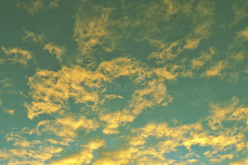 Global warming, twilight sky evening time, sunshine yellow gold on cloud blue sky background royalty free stock images