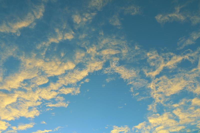 Global warming, twilight sky evening time, sunshine yellow gold on cloud blue sky background royalty free stock image