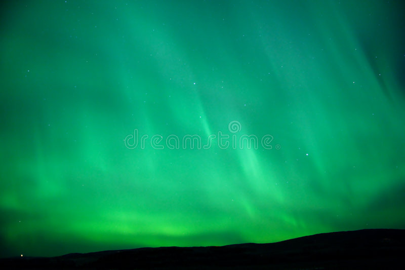 Download The Sky Glowing Green - Aurora Borealis Stock Image - Image: 396703