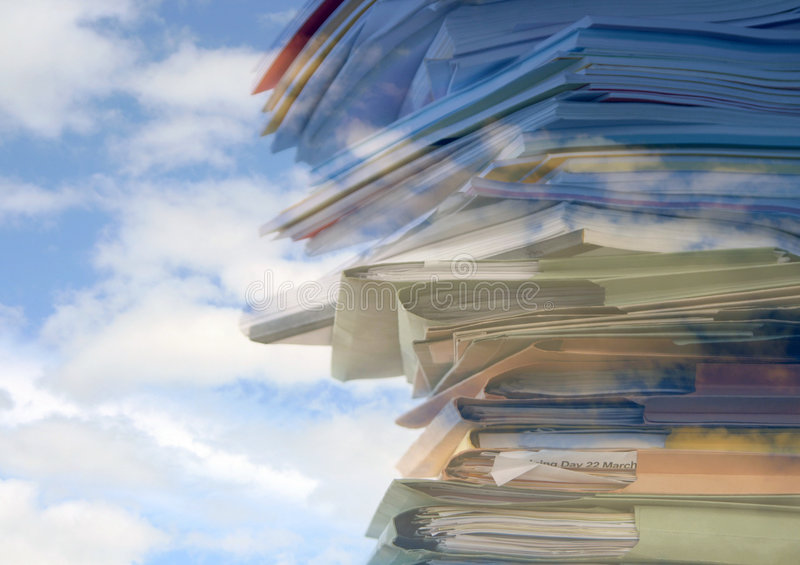Sky high paperwork. Stack of office folders, reports and paperwork overlaid with cloud pattern royalty free stock photos